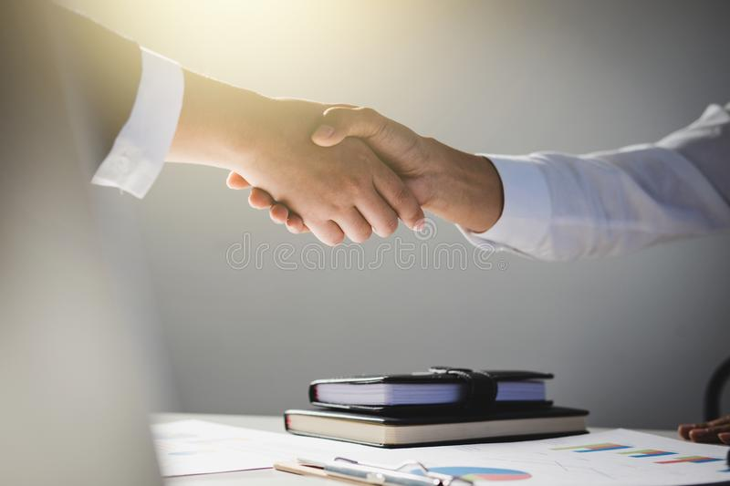 Teamwork process, Image of business team greeting handshake. Successful business people handshaking after good deal, success, dea. Ling, greeting & business stock photography