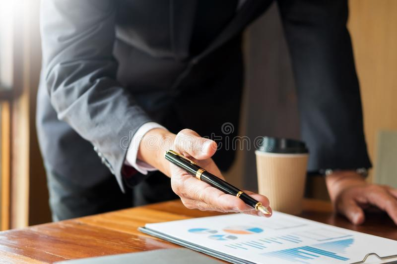 Teamwork process. young business manager working startup project. Laptop on office with laptop, tablet and graph data documents on his desk royalty free stock photos