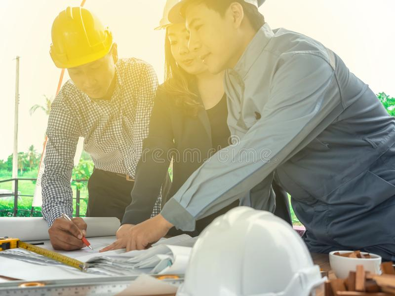 Teamwork of Professional engineer are discussing the project building plan with his business client royalty free stock image