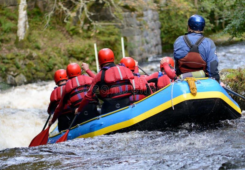Teamwork raft. Concept of teamwork a group white water raffting royalty free stock image