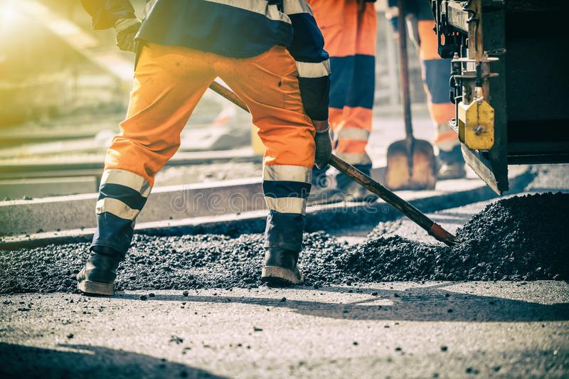 Teamwork on road construction. Teamwork, Group of workers on a road construction, team of people at work royalty free stock photography