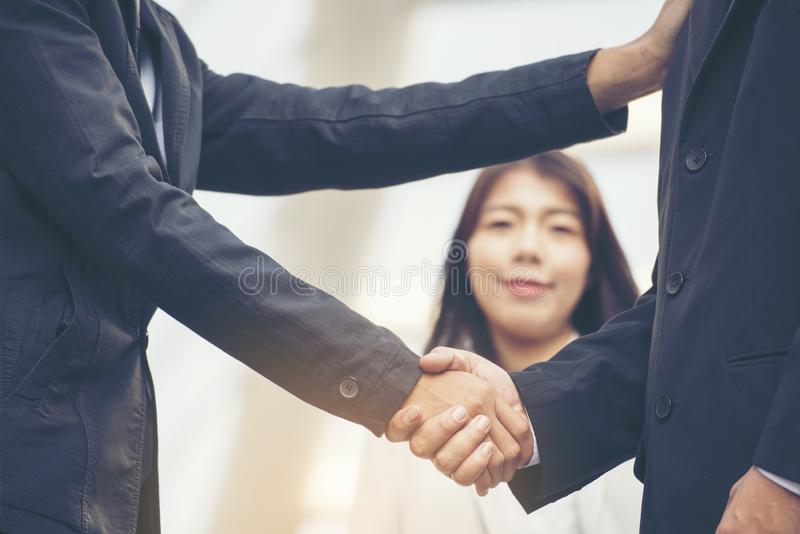 Teamwork Shake Hands together Partnership Concept. Trust business complete deal. Teamwork collaboration communication concept. Asian Business people working royalty free stock photos