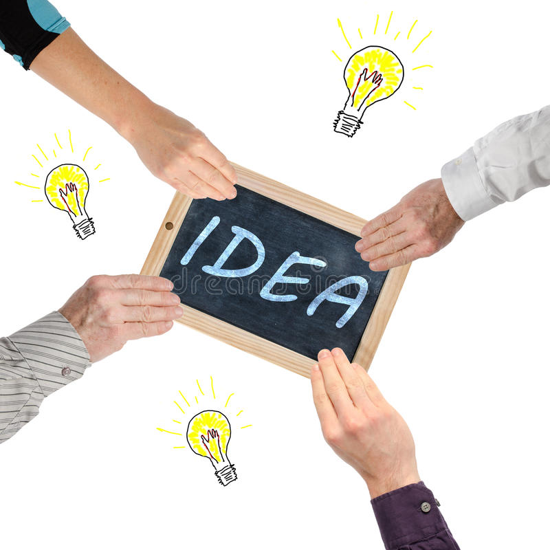 Teamwork and sharing of ideas stock photos