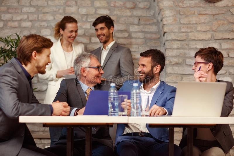 Teamwork of smiling business people on meeting royalty free stock photos