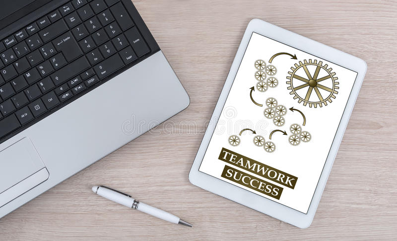 Teamwork success concept on a digital tablet royalty free stock image