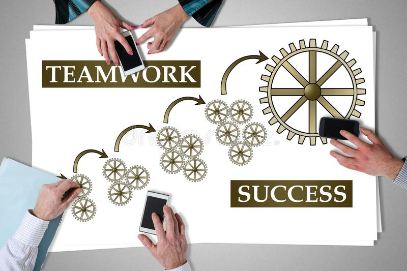 Teamwork success concept placed on a desk royalty free stock images