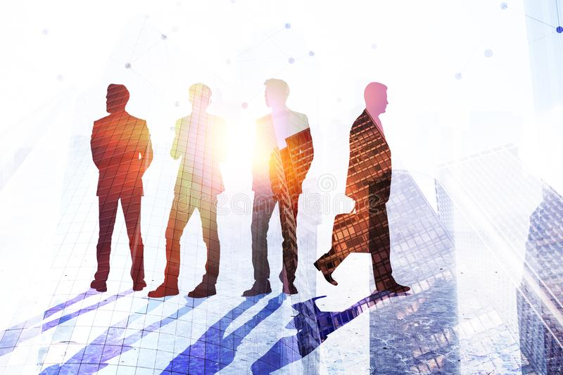 Teamwork, success and job concept. Businesspeople silhouettes on abstract city background with sunlight. Double exposure stock photos