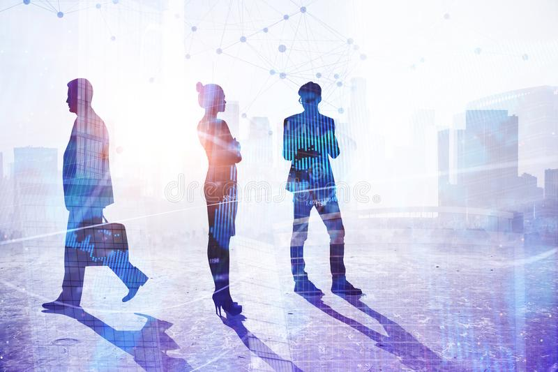 Teamwork, success and occupation concept. Teamwork, success and concept. Businesspeople silhouettes on abstract city background with sunlight. Double exposure royalty free stock photography