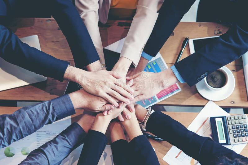 Teamwork Success. Top view executive business people group team happy showing teamwork and joining hands after meeting partner bu royalty free stock images