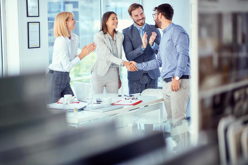 Teamwork- successfully completed business meeting. In office stock images