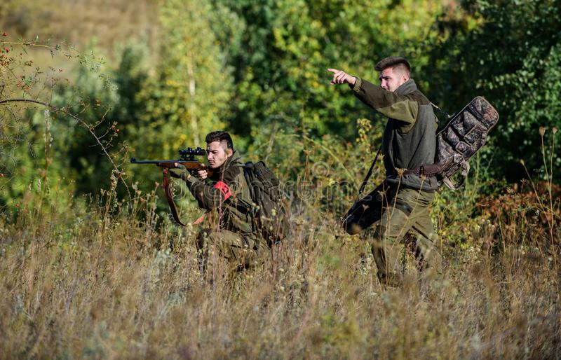 Teamwork and support. Activity for real men concept. Hunters gamekeepers looking for animal or bird. Hunting with royalty free stock photos