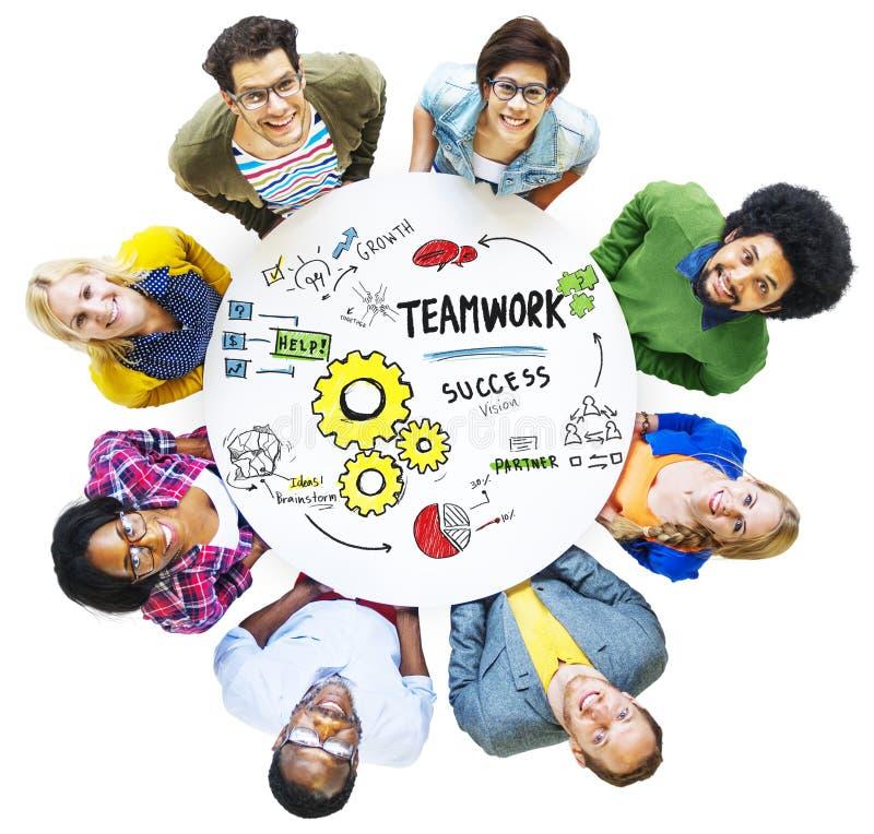 Teamwork Team Together Collaboration Meeting Looking upp begrepp royaltyfri foto