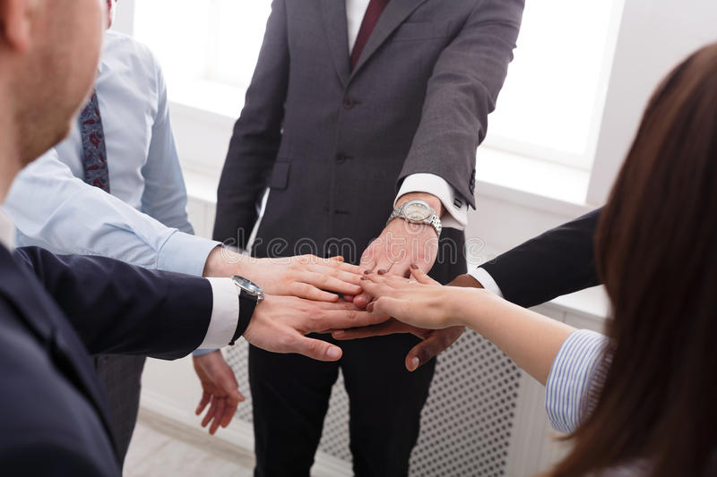 Teamwork and teambuilding concept in office, people connect hand, closeup. Multiethnic Team put hands together, connection, teambuilding and alliance concept stock photos