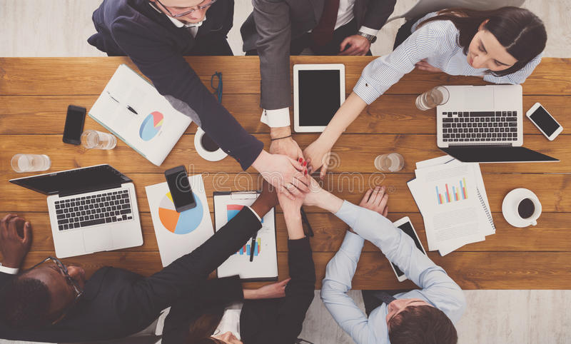 Teamwork and teambuilding concept in office, people connect hand. Multiethnic Team put hands together, connection, teambuilding and alliance concept. People in royalty free stock photo