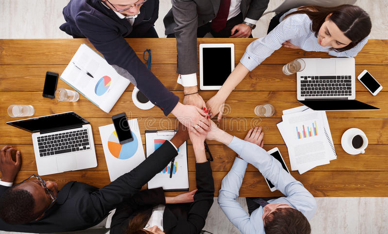 Teamwork and teambuilding concept in office, people connect hand. Multiethnic Team put hands together, connection, teambuilding and alliance concept. People in royalty free stock photos