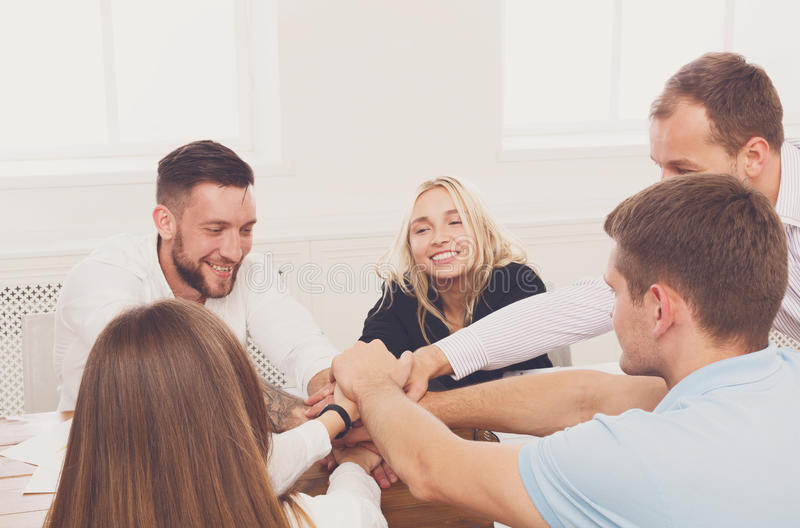 Teamwork and teambuilding concept in office, people connect hand. Team put hands together, show connection and alliance. Teambuilding in office, young happy stock images