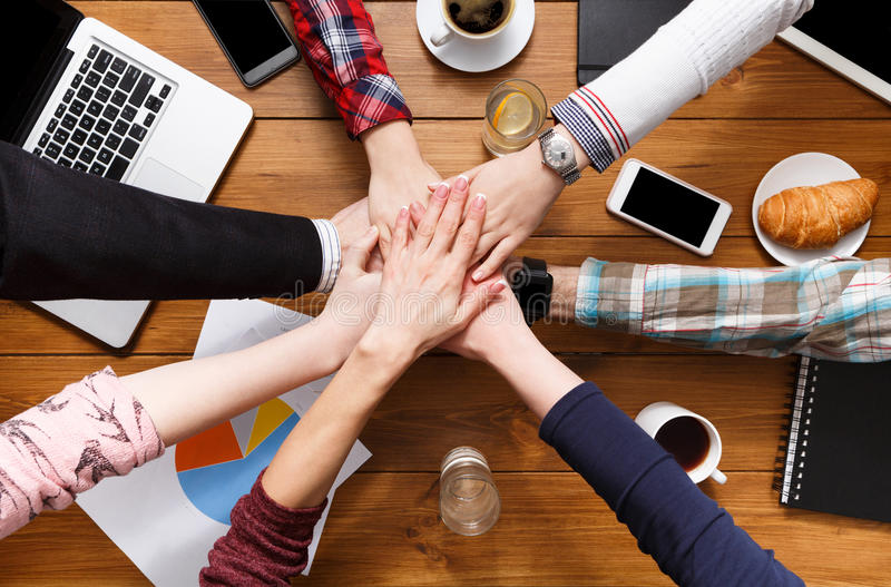 Teamwork and teambuilding concept in office, people connect hands royalty free stock photos