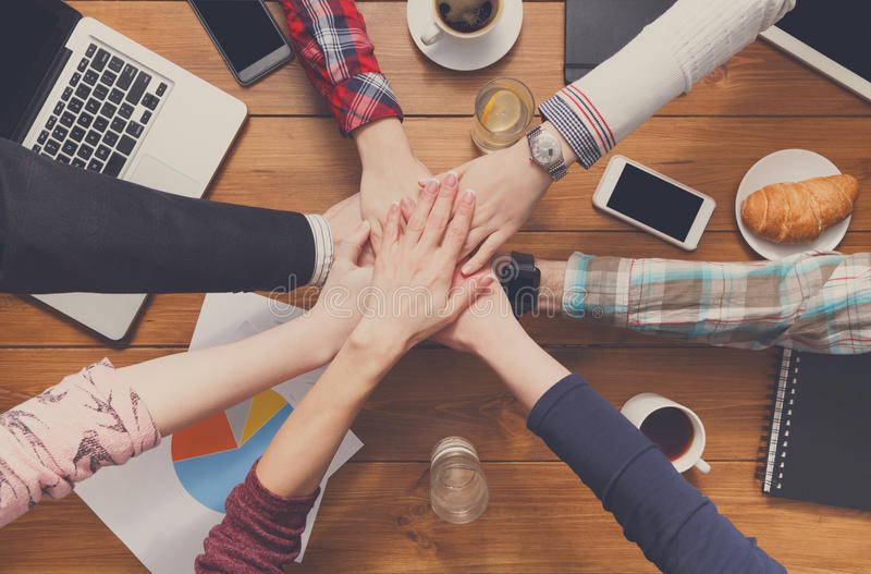 Teamwork and teambuilding concept in office, people connect hands royalty free stock photography