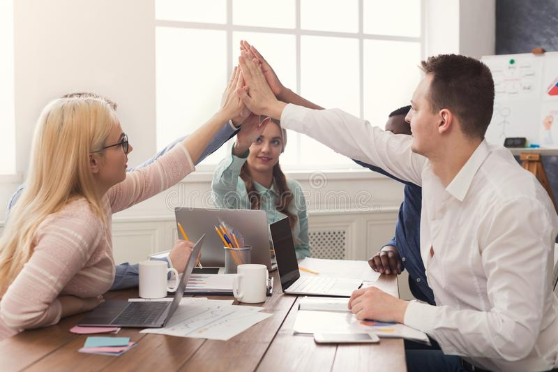 Teamwork and teambuilding, people connect hands. Multiethnic team put hands together, connection, teambuilding and alliance concept. People in office unite for royalty free stock photos