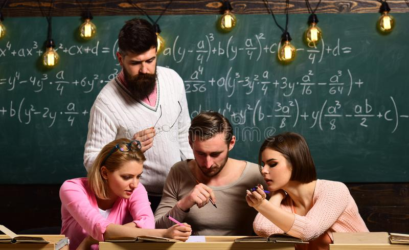 Teamwork. teamwork of students working together in school classroom. group of people makes perfect teamwork. teamwork stock image