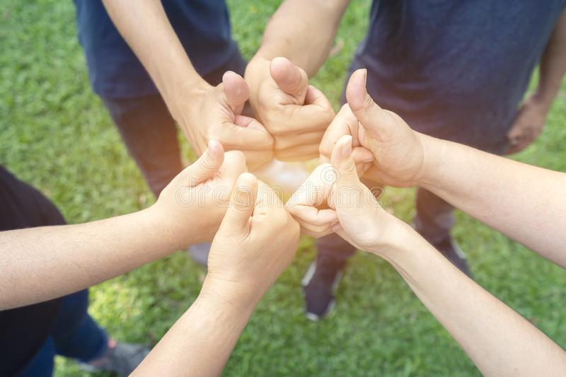 Teamwork togetherness collaboration concept, Group of people giving a thumbs up gesture of approval an success with their hands stock photos