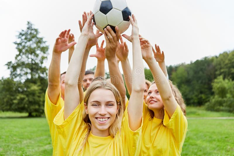 Teamwork training with the football. Young women and her team are doing teamwork training with the football royalty free stock photo