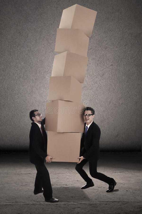 Download Teamwork Try To Balance Heavy Boxes Royalty Free Stock Images - Image: 27095479