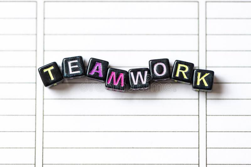 Teamwork word from blocks on clean page notebook close up stock photo