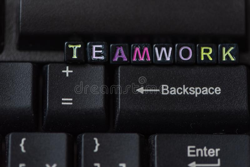 Teamwork word from blocks on keyboard close up. Team work concept, achievement, conceptual, solving, strategy, crossword, group, project, action, business royalty free stock images