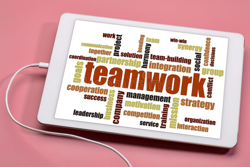 Teamwork word cloud on tablet. Teamwork word cloud on a digital tablet against pink background royalty free stock image
