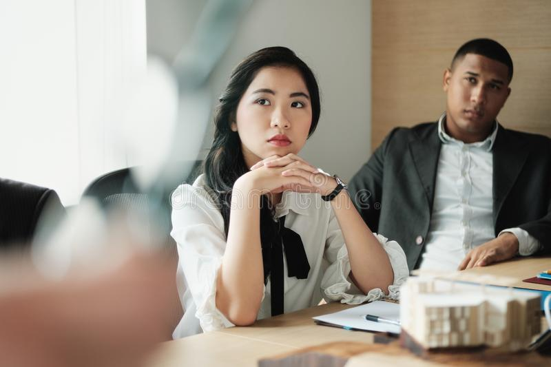 Teamwork With Young Asian Business Woman And Black Businessman stock images