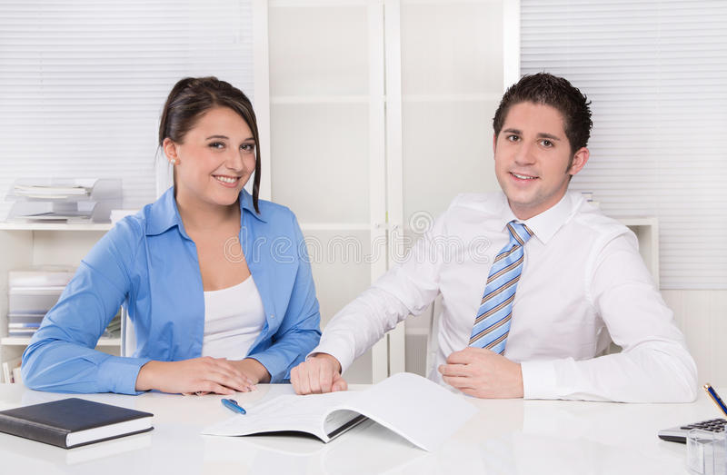 Download Teamwork - Young Business Colleagues In A Meeting Discussing - Y Stock Photo - Image: 35120808