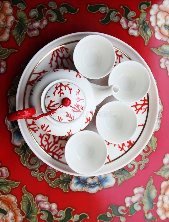 Teapod et cuvettes photo stock