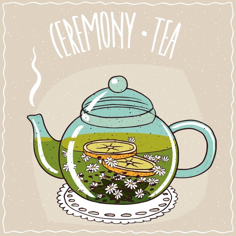Teapot γυαλιού με το chamomile τσάι απεικόνιση αποθεμάτων
