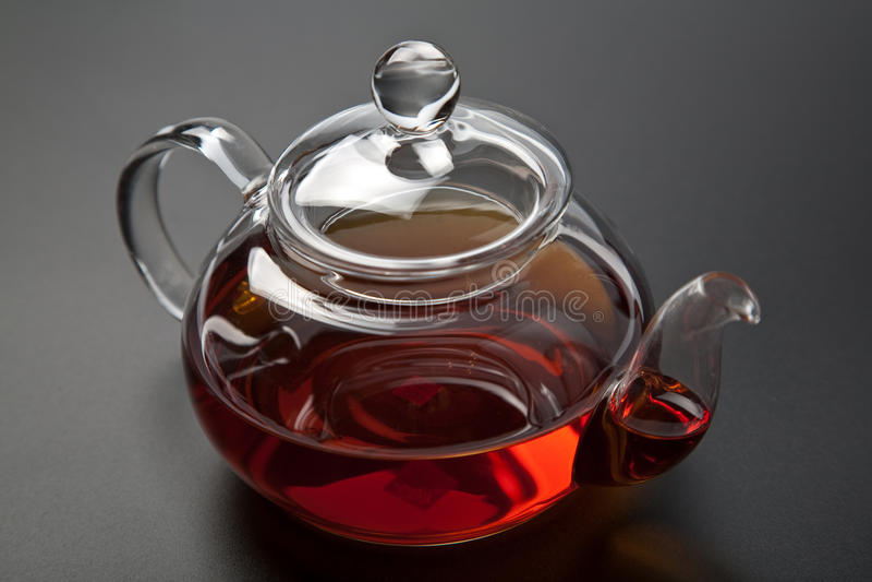 Teapot with black tea stock photography