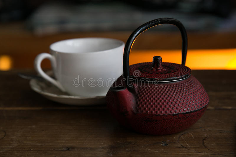 Teapot with cup ready to be served royalty free stock photography