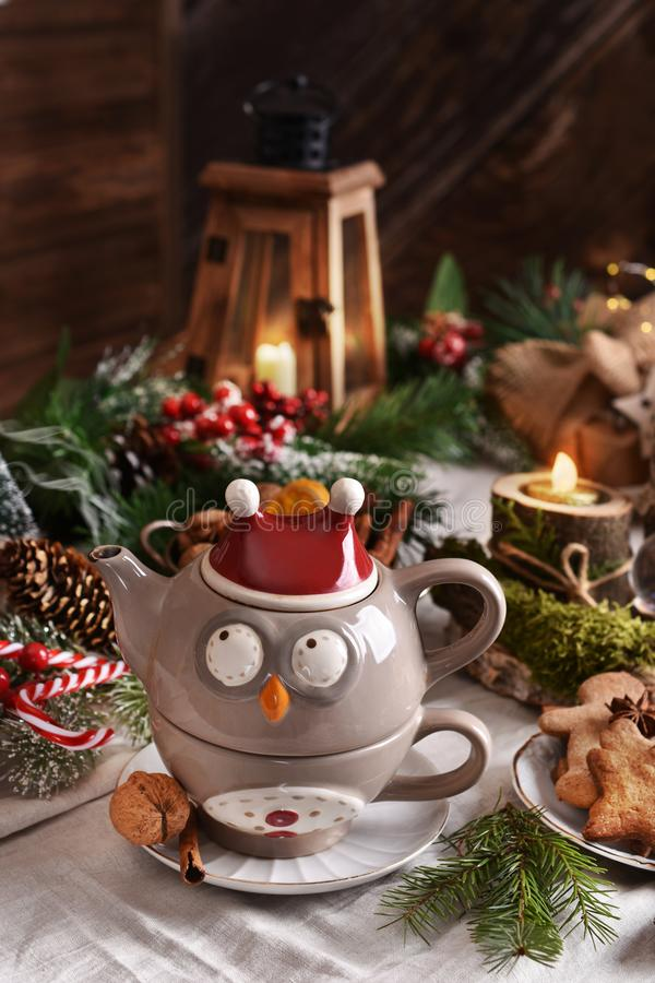 Teapot and cup set in owl shape for Christmas tea stock images