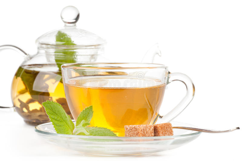 Teapot and cup of tea with mint. stock images