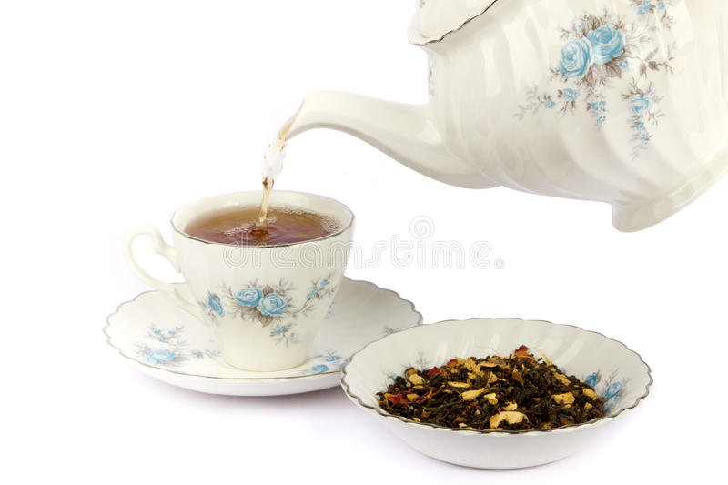 Teapot and a cup stock image