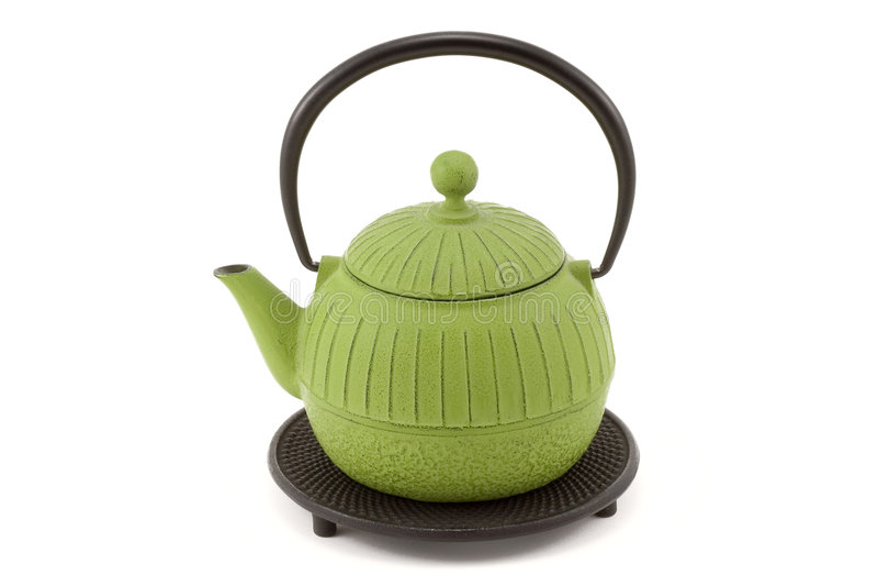 Teapot em Trivet fotos de stock royalty free
