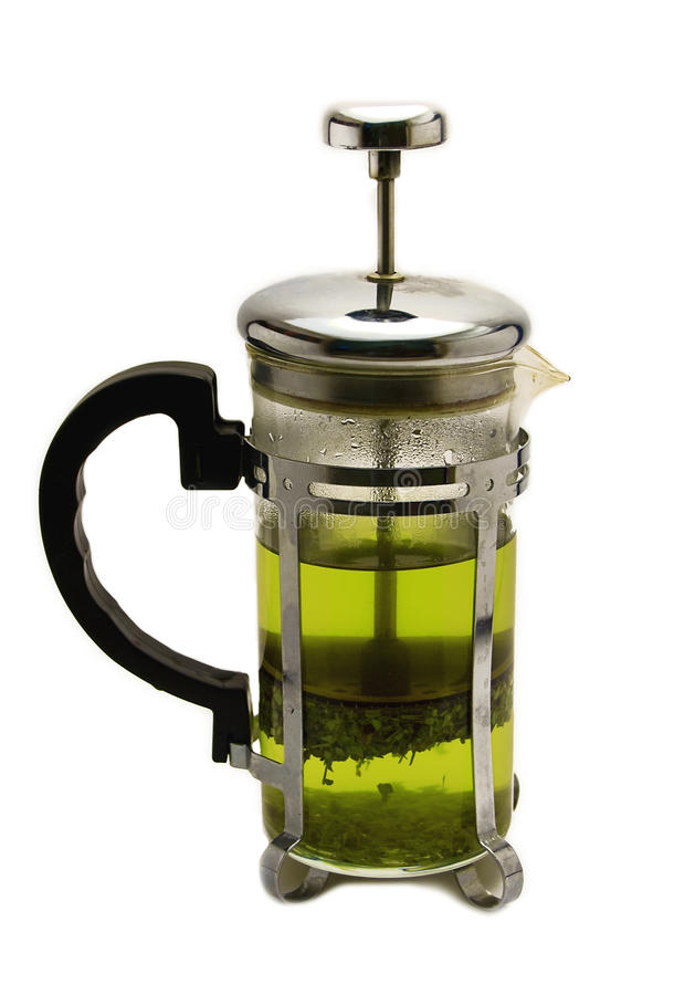 Teapot with green tea royalty free stock photos