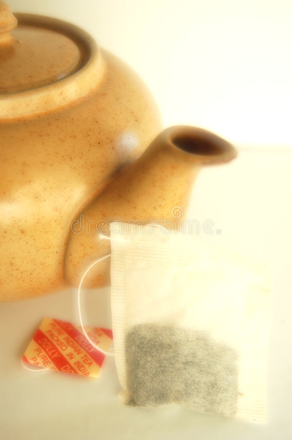 Teapot and his tea bag royalty free stock photos
