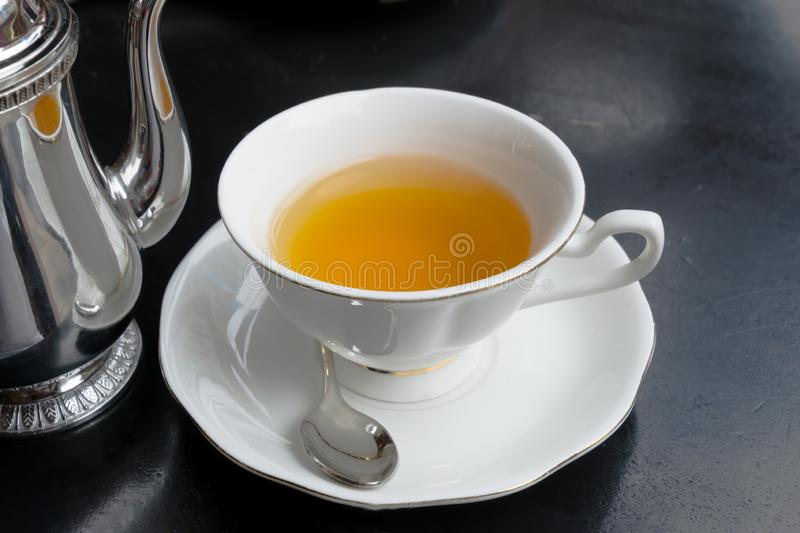 Teapot pouring herbal tea into a cup. The concept of healthy eating. Drink, hot, beverage, breakfast, green, liquid, table, background, food, fresh, freshness stock images