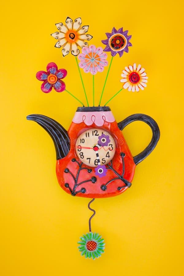 Teapot Shape Clock On Yellow Wall Stock Image - Image of retro ...