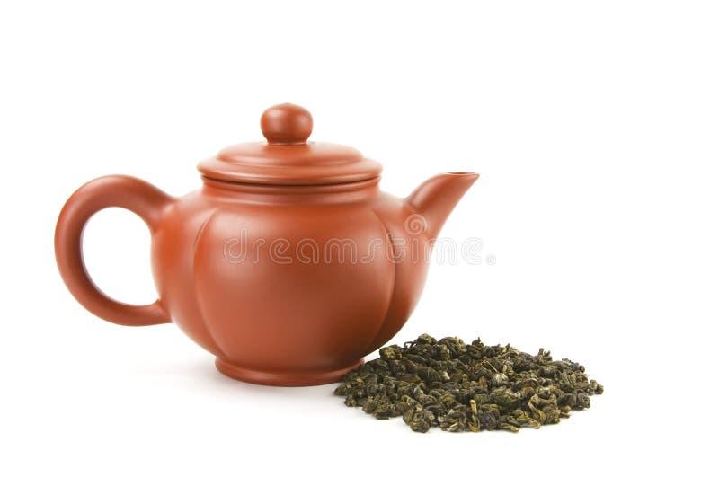 Teapot and tea royalty free stock photos