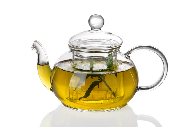 Teapot with tea and fresh leaves royalty free stock photo