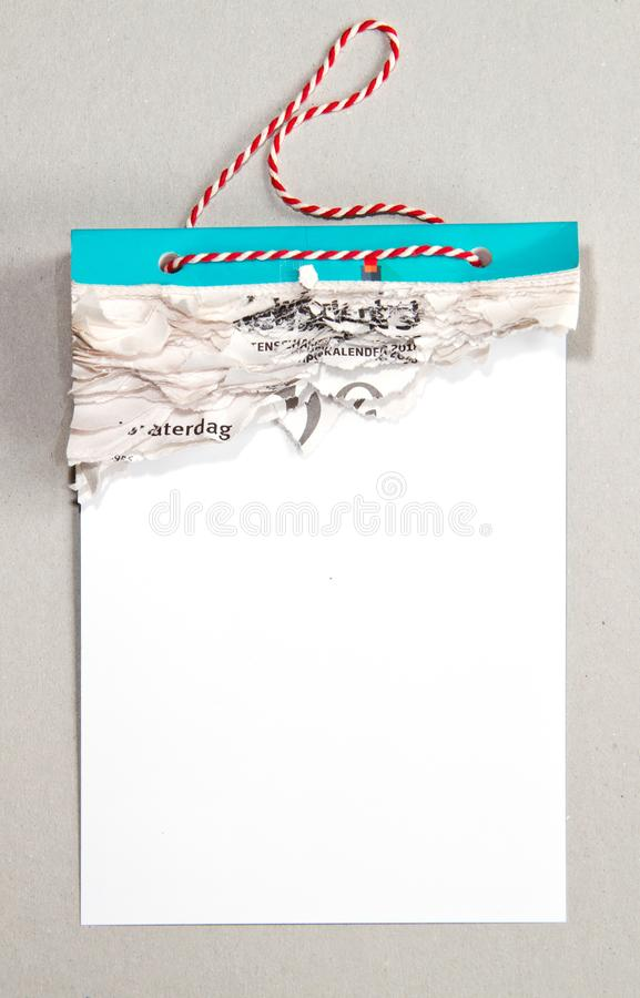 Tear calendar with all pages gone. Tear calendar with a red and white cord, all pages gone, on a grey background royalty free stock photos