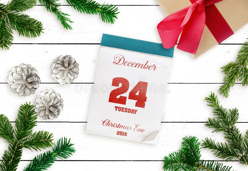 Tear-off calendar on December 24 Christmas Eve 2019 on white wooden table. Top view of tear-off calendar on December 24 Christmas Eve 2019 on white wooden table royalty free stock photo