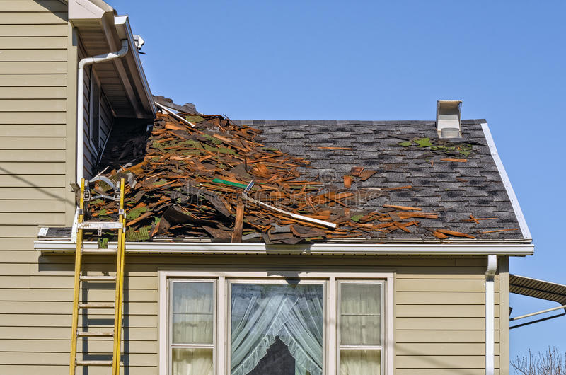 Tear Off of Old Shingled Roof. Old Roofing Being Removed on House to be Replaced by New Shingles stock photography