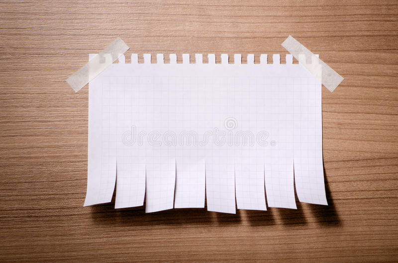 Tear off paper notice. On the wall royalty free stock photography